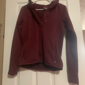 Red north face pull over